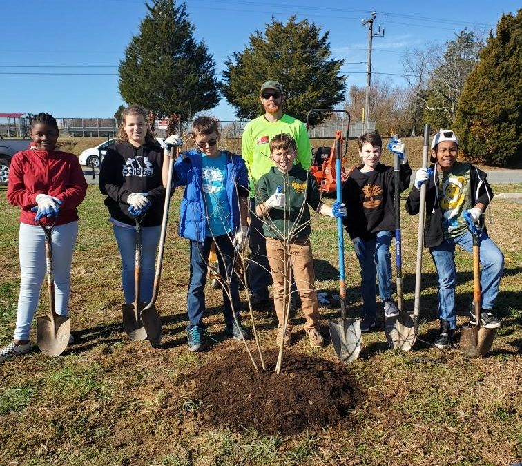 Students Planting Roots in Environmental Education
