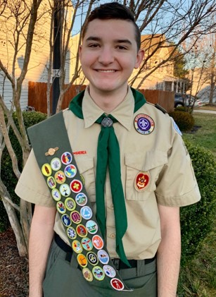 Boy scout with sash and badges